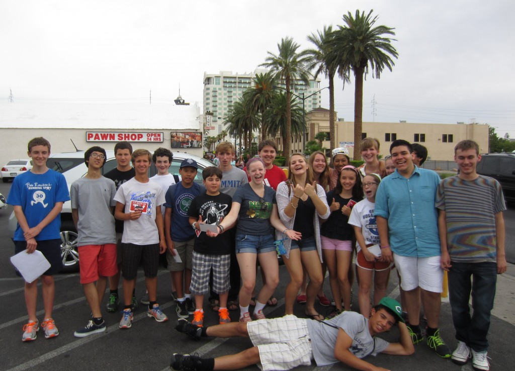 Most of the group poses for a picture at 'Pawn Wars' shop.