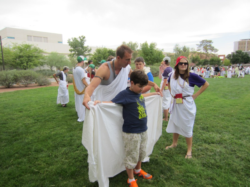 Greg Stemm, aka Prime, helps Christopher with his toga.