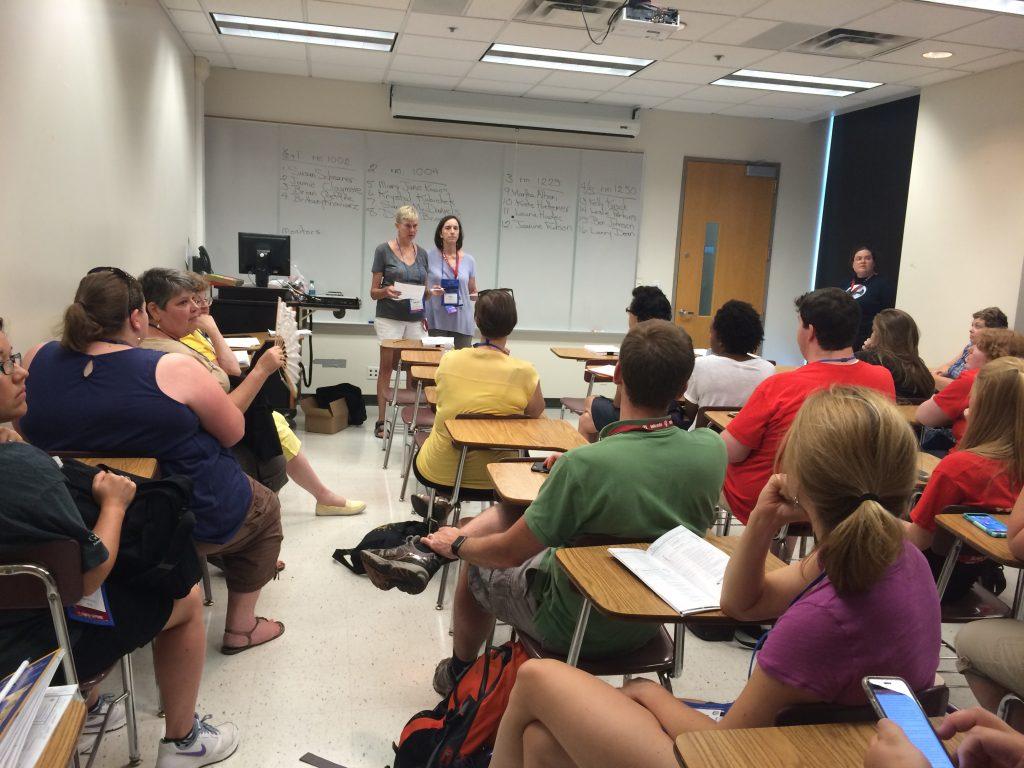 Teachers prepare to judge Latin Oratory.