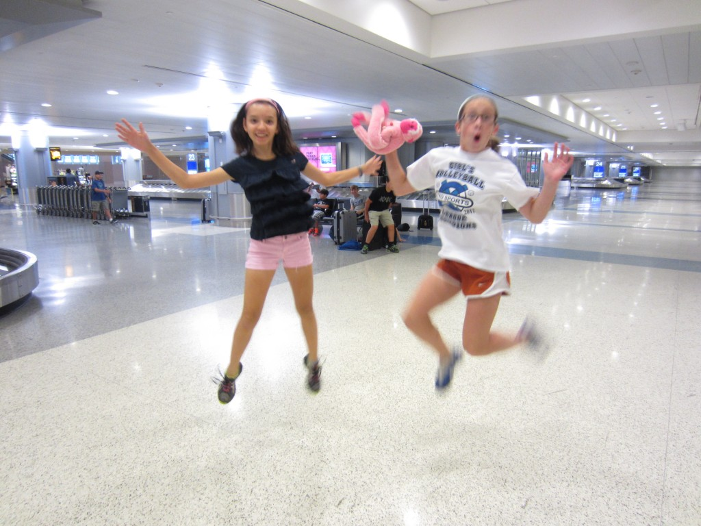 Grace and Julia have fun at the airport.